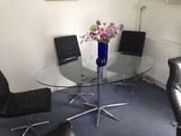 Clear glass oval dining table