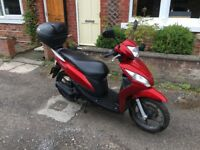 Honda vision 50. Very low milage. Comes with top box.