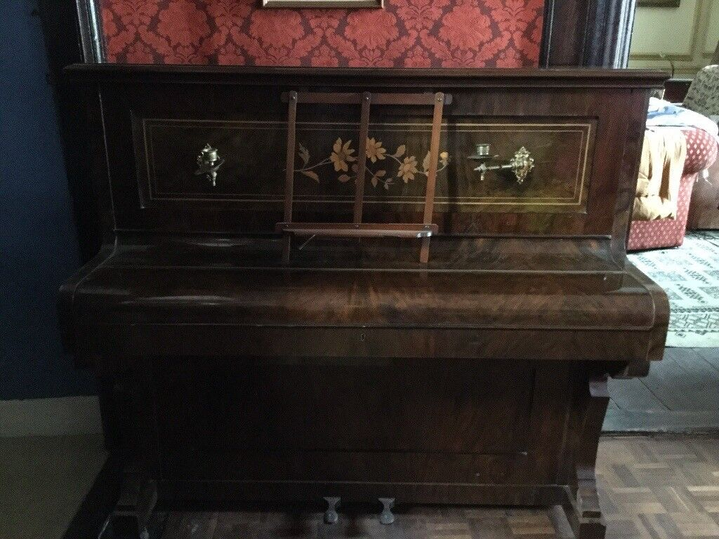 Piano - ornate - with candle stick holders