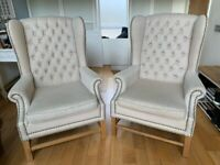 Two stylish wing back armchairs