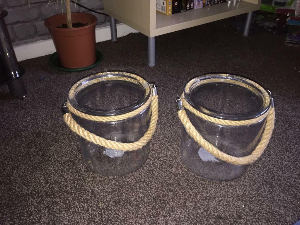 Two very large glass 'baskets' with rope