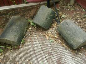 Copping stones have been used upside down as garden seating