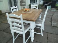 farmhouse dining table and chairs, solid top and chunky turned legs. Chairs, base painted white