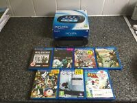 Sony vita. Original box. As new condition. Memory card and 7 games
