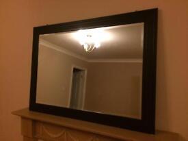 Large dark brown framed mirror
