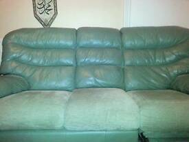 Three seater green leather recliner sofa