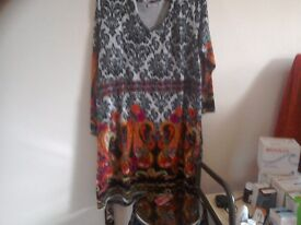 For sale we have a joe brown dress never worn