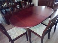 Mahogany extending dining table with six chairs, good condition