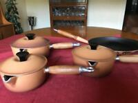 Three Le Creuset saucepans and frying pan