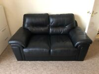 2 seater leather sofa, excellent condition.