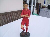 Statue of a retro footballer.