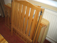 Wooden cot with slatted base