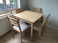 Extendable dining table and 4 chairs £85 ono