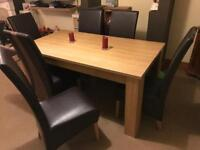 Oak effect dinning room table and six chairs