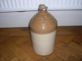 An F.E. Jennings of Bury St Edmunds earthenware flagon.