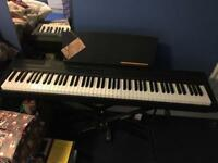 Yamaha P-105 digital piano w/case, stand and pedal
