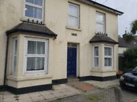 LONG ROCK, Penzance - spacious ground floor two bed flat, gas central heating and off road parking
