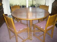 Old Charm extending round dining table and 4 chairs