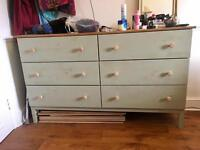 Large wooden chest of drawers painted in antique green colour