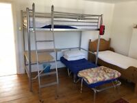 Metal John Lewis single bed with guest bed