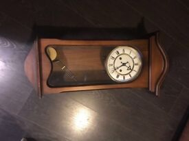 Wall chiming clock in working order and good condition.