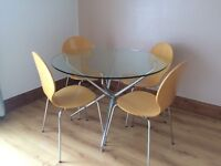 Round tempered glass dining table with 4 chairs. Perfect condition. £60 East Belfast