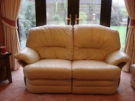 two seater cream leather settee and matching cuddle armchair, all recliners