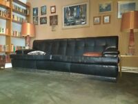 Large comfortable black leather sofa