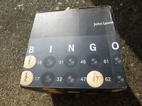 Bingo set with rotating drum, wooden counters and reusable game cards