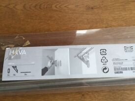 Double rail curtain pole in polished steel. By Ikea.