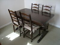 Ercol Dark Oak extending table and six chairs