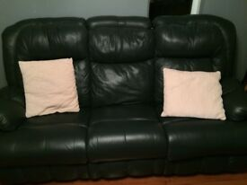 2 Black Leather Three Seater Recliner Sofas