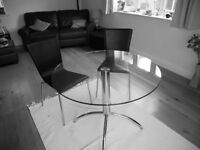 Glass dining table and 2 chairs.