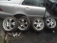 215 40 r17 - 17 inch alloys chrome - 4 stud - nice wheels - rims - 2 good tyres and 2 bad