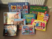 Various children's board games and puzzles