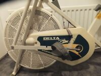 Professional quality exercise bike with cross trainer handles by Delta