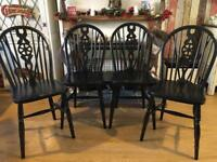 Black dining chairs with a glittery shimmer
