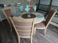 round marble dining table and four chairs