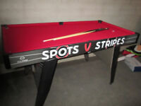 Spots V Stripes 5 ft Pool Table, 2 Cues and new set of larger Riley Pool Balls