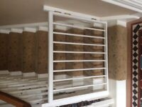 2 white stair gates for sale.