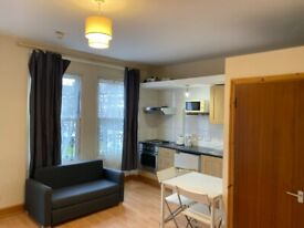 099T-1FF-WEST KENSINGTON- MODERN STUDIO FLAT, OPEN PLAN KITCHEN,FURNISHED,BILLS INCLUDED-£260 WEEK