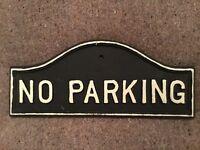 Sign. Cast iron. Reads 'NO PARKING'