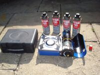 Nearly New Portable Camping Stove and 5 Canisters of Gas