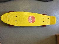 Skateboard. Yellow stereo banana board