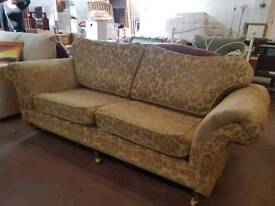 Patterned fabric two and three seater sofa on castors