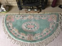Quality 100% Wool Rug - very good condition half moon shape lined backing