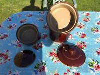 Three earthenware casserole pots.