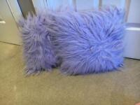 Purple pillow and rug