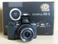 Olympus OM-D E-M10 & 14-42mm EZ lens. Boxed with spare battery and case.