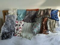 A selection of assorted wool, cashmere, silk and other miscellaneous scarves and shawls.